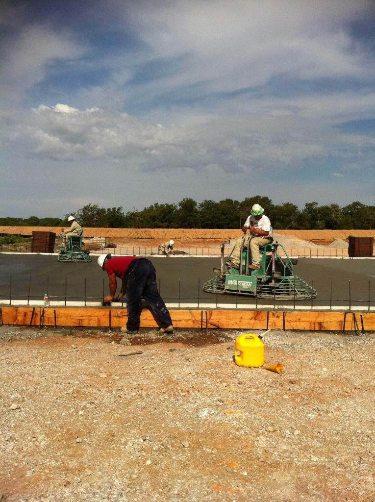 construction workers finishing the concrete layout