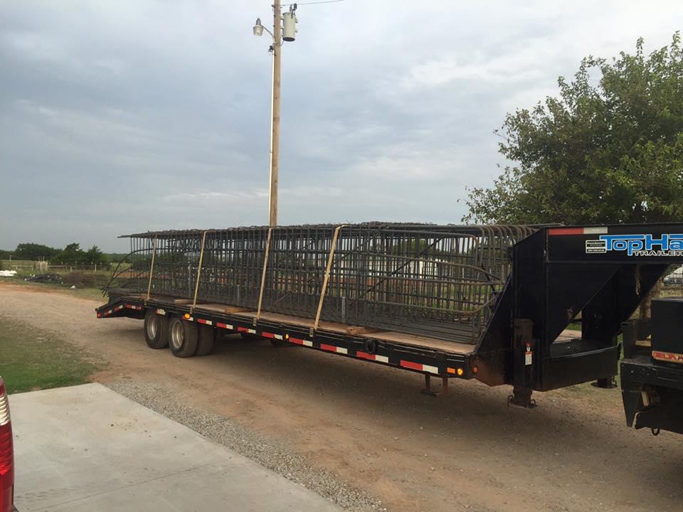 reinforcement bars being delivered