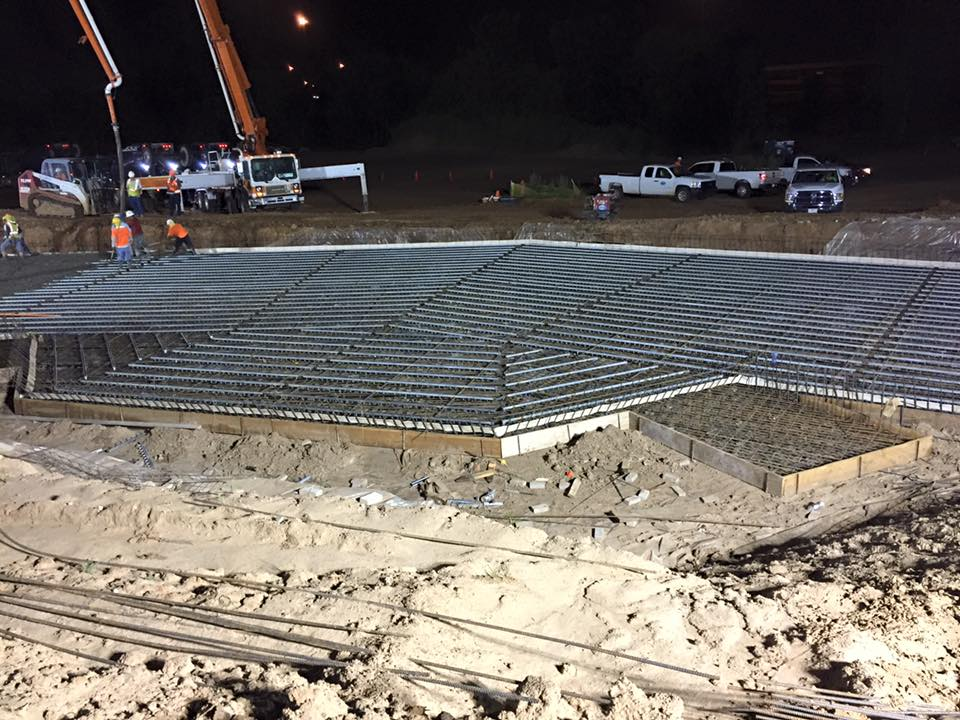 workers are pouring concrete for the channel Riversport Rapids Whitewater Rafting and Kayak Center