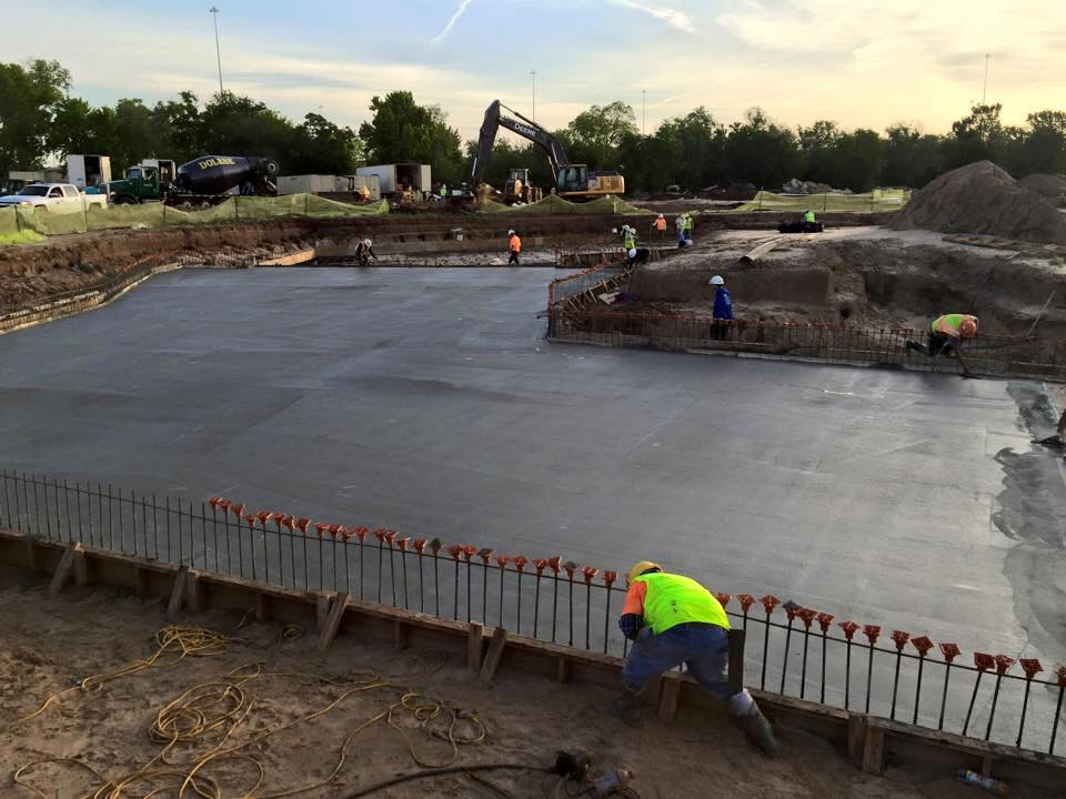 workers finishing the channel flooring