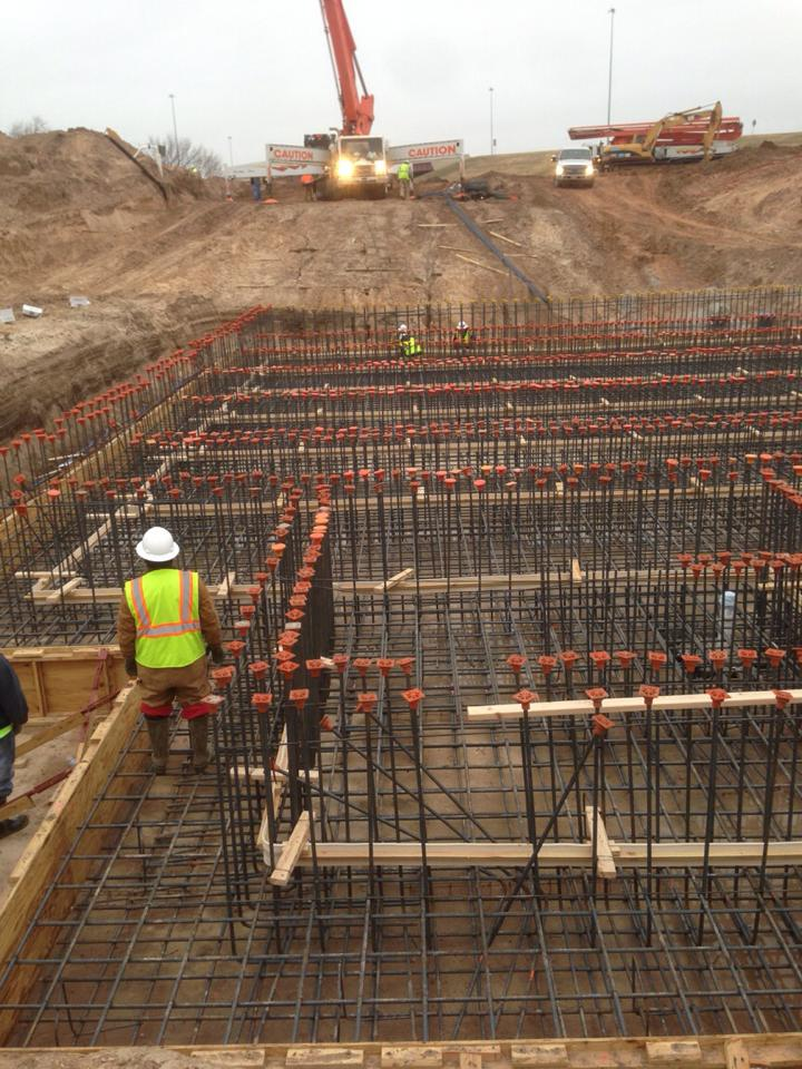 construction workers checking the concrete layout before pouring